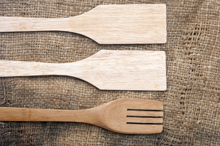 wooden utensils on old worn burlap photo