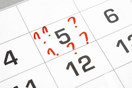 question marks on the calendar at 5.  photo