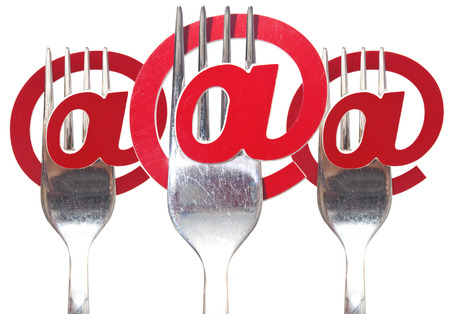 email symbol on a fork isolated on white background  photo