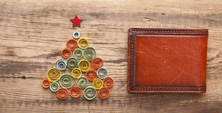 curling paper Christmas tree on wood background photo
