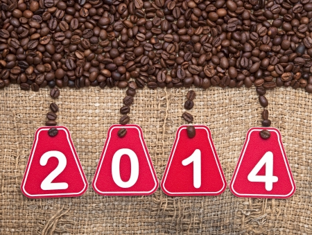 2014 text and coffee beans on a old burlap background  photo