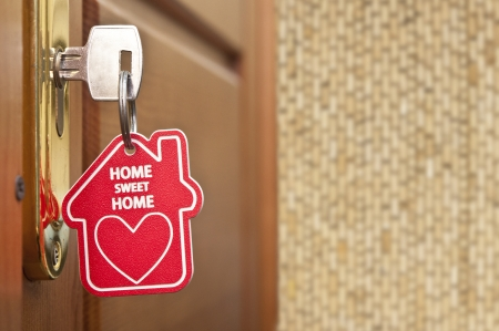 home safety: key with label home