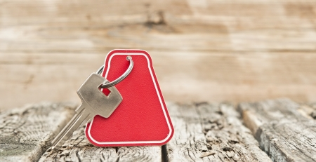 key with a blank label on an old wooden plank Stock Photo: Image ID: 156032894  photo