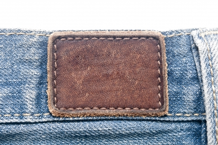 Leather jeans label sewed on jeans.  photo