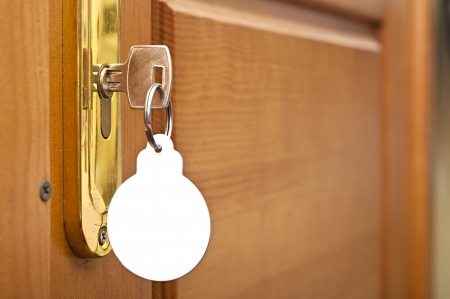 open hole: key in keyhole with blank label shape Christmas ball