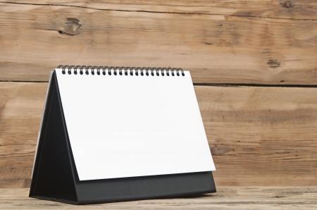 almanac: Blank calendar on wood table
