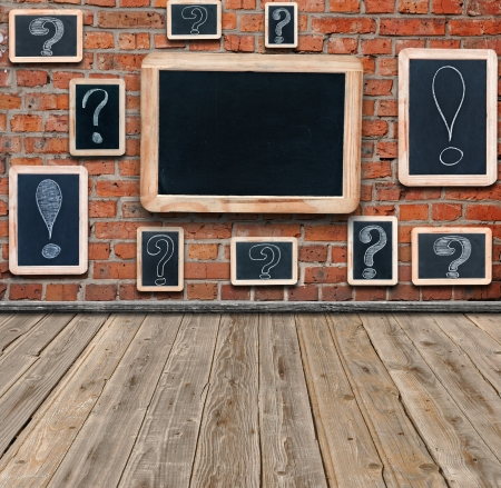 proclamation: Question marks and exclamation marks white chalk drawing on small blackboard hanging in old room and large chalkboard with copy space for your text Stock Photo