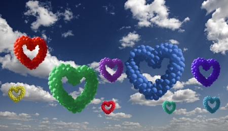 heart-shaped colorful baloons in the sky, the symbols of love photo