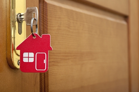 mortgage: A key in a lock with house icon on it