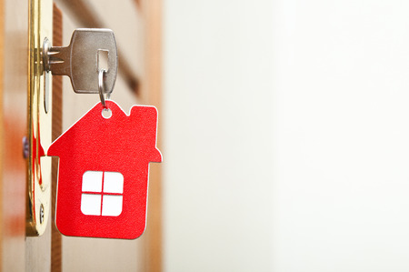 secure home: Symbol of the house and stick the key in the keyhole  Stock Photo