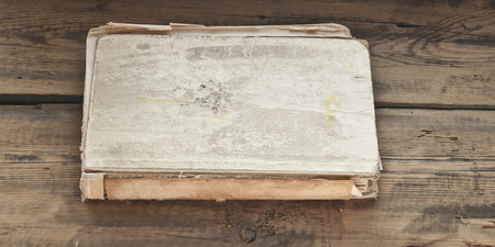 Old book on wooden background  photo