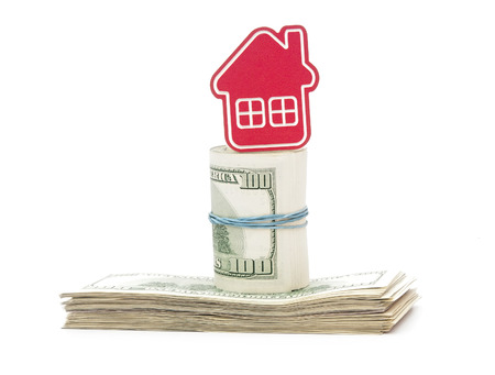 downpayment: red home sign on hundred dollar bills. Real Estate business Concept