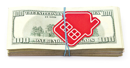 red home sign on hundred dollar bills. Real Estate business Concept   photo