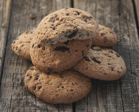 Oatmeal cookies with raisins on vintage wooden background  photo