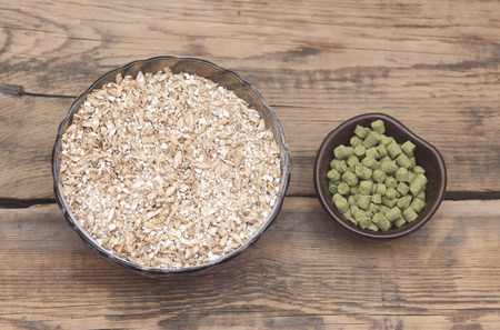 barley with pellets of hops photo