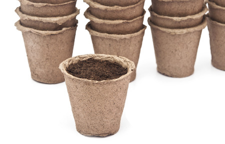 turf pile: pile peat pots for growing seedlings, isolated on white background