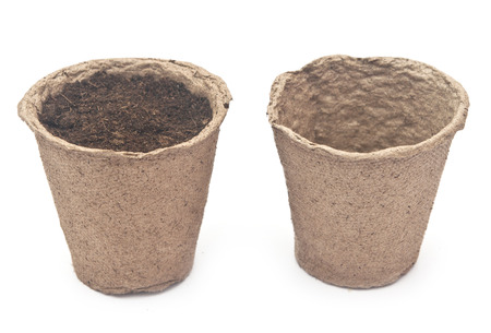 peaty: pile peat pots for growing seedlings, isolated on white background