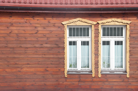 white windows on red wooden wall  photo