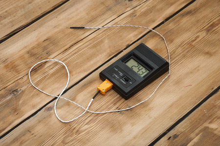 table top: Digital thermometer on wooden table top