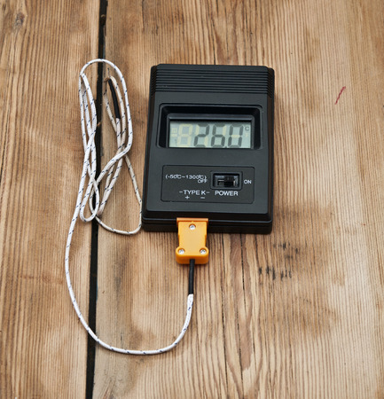 digital thermometer: Digital thermometer on wooden table top
