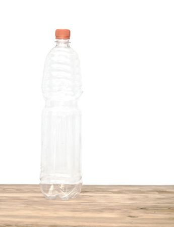 discarded: Plastic bottle isolated on white