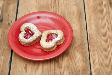 chip cookies in the form of heart on a plate photo