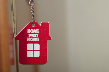 key with label home photo