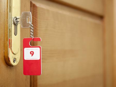 view through door: Key in hotel rooms door Stock Photo