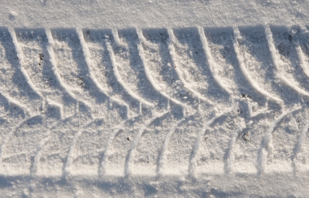 tire tracks: Close-up car tire tracks in the snow
