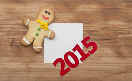christmas cookie: Christmas 2015 cookie with homemade christmas painted gingerbreads (gingerbread man) on the wooden background