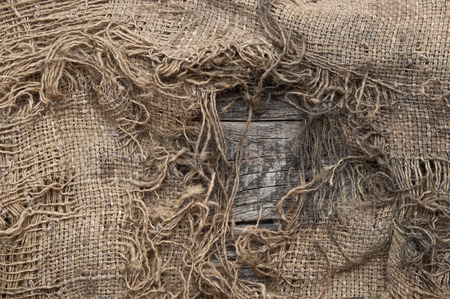 fray: background of burlap with a hole for writing text. texture of the wood Stock Photo