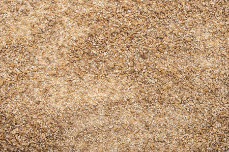 grind: Roughly grind barley texture background Stock Photo