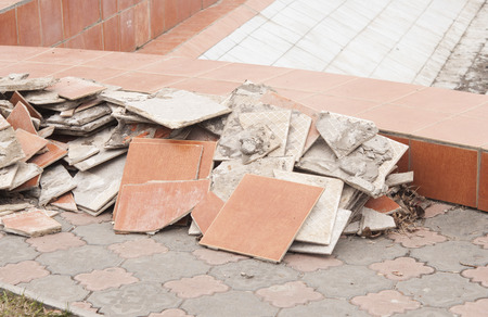 disposed: A pile of trash, various disposed, broken tiles Stock Photo