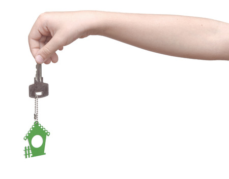kids hand: House key in kids hand over white background