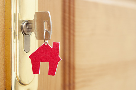 estate: Symbol of the house and stick the key in the keyhole