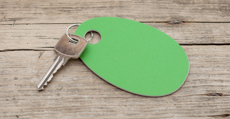 occupancy: key with a blank label on an old wooden plank
