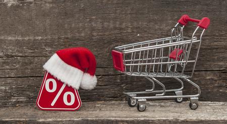 christmas profits: Symbol of percent and a christmas hat