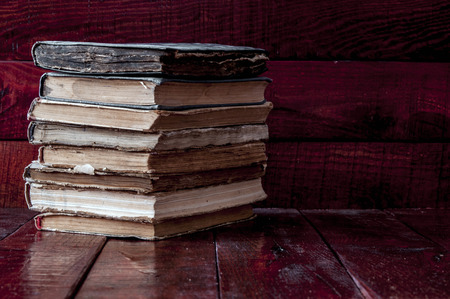 bible story: Pile old books on the tabletop. Stock Photo