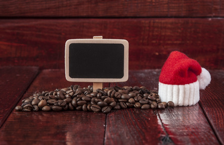holiday food: Christmas coffee beans and blank chalkboard on wooden table Stock Photo