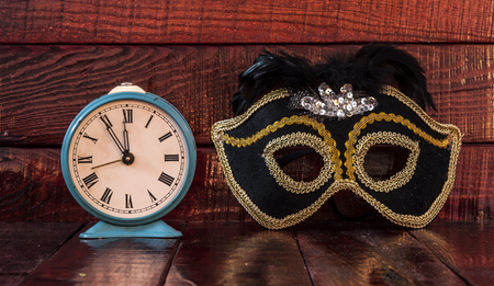 midnight: New years mask and clock just before midnight