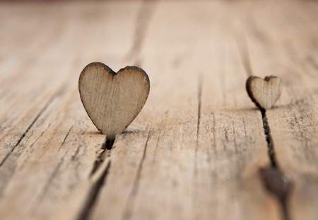 nicely: wooden hearts placed nicely on vintage wood background