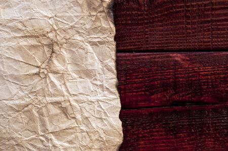 desperado: Grunge paper on wooden background Stock Photo