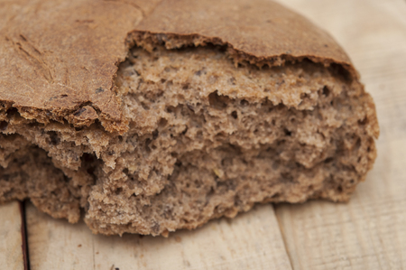 starvation: homemade rye bread broken into pieces Stock Photo