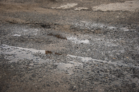 blacktop: Drops of rain water on a fresh asphalt in the sun. Stock Photo