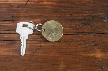hotel chain: Metal key chain  on vintage wooden background Stock Photo