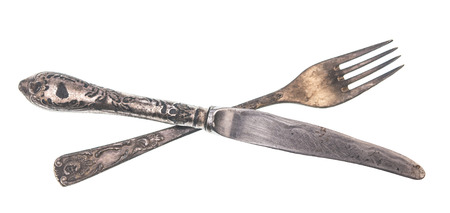 Vintage fork and knife isolated on white