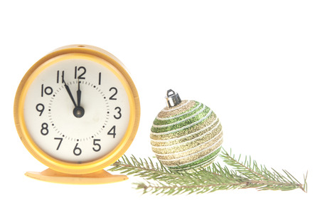Retro alarm clock, decorations and Santa hat on white background. Christmas countdown concept
