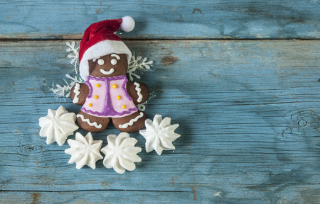 Gingerbread cookies on wooden table. Merry Christmas and Happy New Year!!