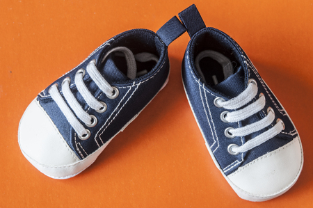 sneakers for baby on the colorful background Stock Photo