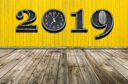 New years resolution 2019 concept. Wooden year number on wooden wall with copy space for your text